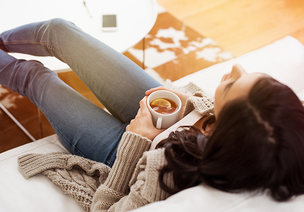 Woman relaxing at home to naturally recharge beauty
