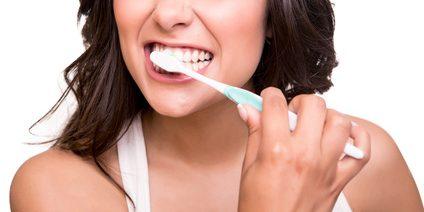 brushing teeth regularly to avoid breakouts